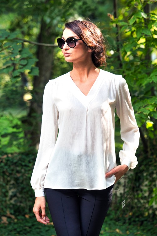 White elegant blouse with V-shaped neckline