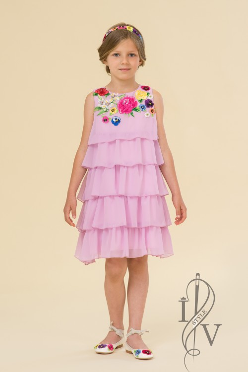 Children pink dress of chiffon flounces