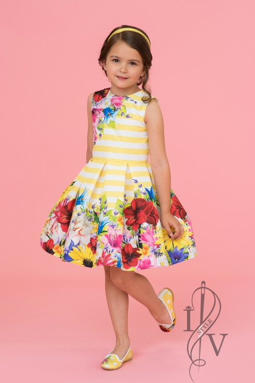 Beautiful yellow children's dress with flowers and stripes