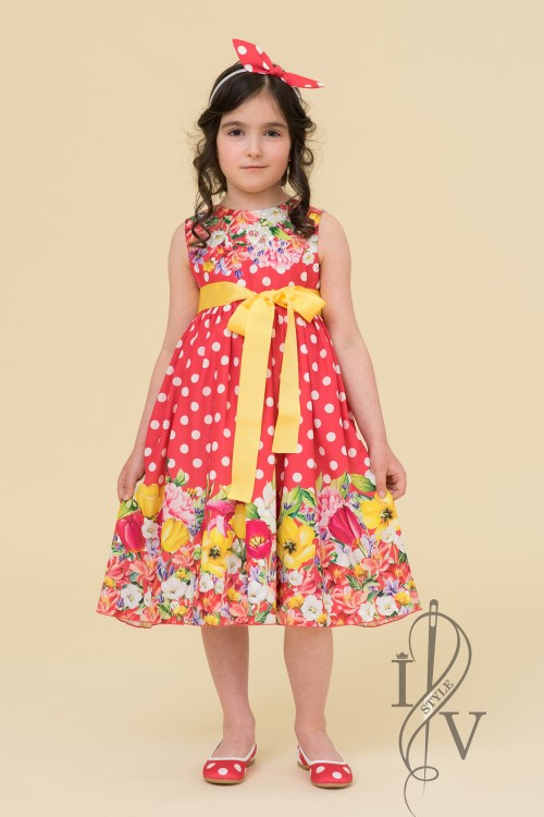 Children's dress of dots and flowers