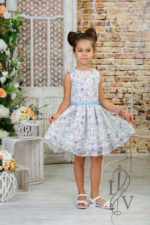 Children lace dress with a blue belt